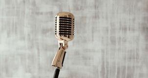 Concert microphone on stage on white background. close up stock video