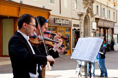 Concert Violinists. Concert in the street of Violinists, Trieste Royalty Free Stock Photography