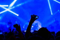 Concert visitor shoots video. On a n action camera Royalty Free Stock Images