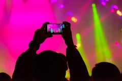 Concert visitor shoots video. On a smartphone Stock Images