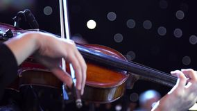 Concert, a woman playing the violin, hand close up stock video