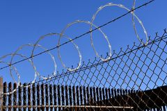 Concertina fence wire in prisons royalty free stock images