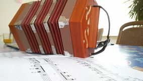 Concertina and music sheets Stock Images