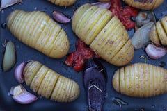 Concertina potatoes. Stock Image