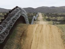Concertina wire on the border wall. Concertina wire on border wall near Sasabe AZ USA stock photos