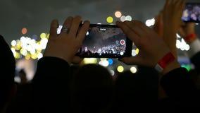 Concerto das luzes da multidão do telefone video estoque