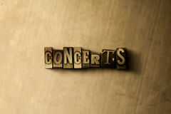 CONCERTS - close-up of grungy vintage typeset word on metal backdrop Stock Images
