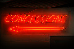 Concessions Neon Sign. Red neon concessions signs with arrow Royalty Free Stock Photos