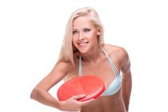 Concetrated woman with frisbee Royalty Free Stock Photography