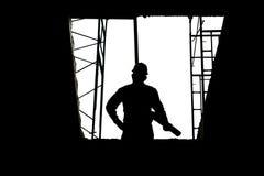 Concetti della costruzione, siluetta dell'ingegnere ed architetto che lavora al cantiere Immagini Stock