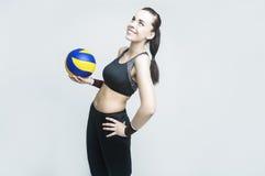Concetti ed idee di sport Atleta femminile professionista di pallavolo con la palla Fotografia Stock