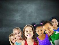 Concetto allegro di felicità di istruzione di diversità dei bambini dei bambini Fotografia Stock Libera da Diritti