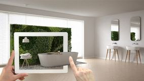 Concetto aumentato di realtà Passi la compressa della tenuta con l'applicazione dell'AR usata per simulare i prodotti di interior illustrazione di stock