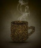 Concetto caldo dei fagioli della tazza di caffè Fotografie Stock
