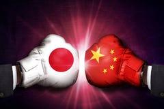Concetto commerciale di conflitto fra la Cina ed il Giappone fotografia stock libera da diritti