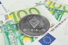 Concetto cripto di valuta - un Ethereum con le euro fatture fotografia stock libera da diritti