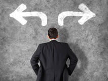 Concetto decisionale - uomo d'affari che prende le decisioni Fotografia Stock