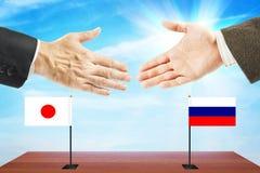 Concetto dei colloqui amichevoli fra la Russia ed il Giappone Fotografie Stock Libere da Diritti