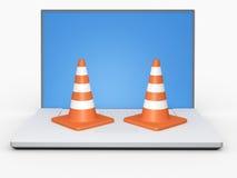Concetto dei coni e del computer portatile di traffico Fotografia Stock Libera da Diritti