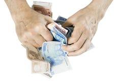 Concetto dei soldi di ingordigia Fotografia Stock
