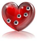 Concetto del cuore del foro di pallottola Immagini Stock