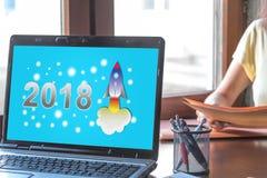 Concetto 2018 del nuovo anno su uno schermo del computer portatile Immagine Stock
