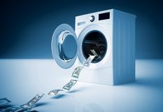 Concetto del riciclaggio di denaro, salto dei soldi nella lavatrice Immagini Stock