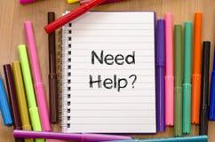 Concetto del testo di aiuto di bisogno Fotografie Stock