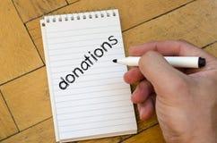 Concetto del testo di donazioni Immagini Stock Libere da Diritti