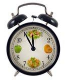 Concetto dell'orologio di dieta fotografia stock
