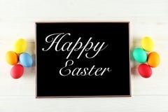 Concetto della cartolina d'auguri di Pasqua Composizione festiva su fondo di legno illustrazione di stock