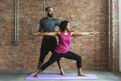 Concetto della classe di esercizio di pratica di yoga Fotografia Stock