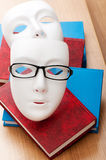 Concetto della lettura con le mascherine, libri Fotografia Stock