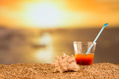 Concetto della spiaggia e di tramonto Immagini Stock