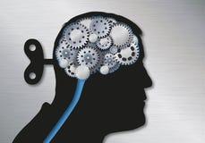 Concetto delle notizie false e della manipolazione simbolizzate da una testa umana con una chiave alla parte posteriore del crani illustrazione di stock