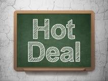 Concetto di affari: Affare caldo sul fondo della lavagna Immagine Stock Libera da Diritti
