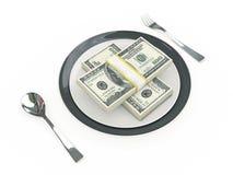 Concetto di affari - banconote del piatto, della coltelleria e del dollaro Fotografia Stock
