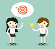 Concetto di affari, due donne di affari che parlano dell'obiettivo e dell'idea Illustrazione di vettore Fotografie Stock Libere da Diritti
