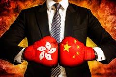 Concetto di affari e politico della guerra commerciale fra Hong Kong e la Cina immagini stock libere da diritti