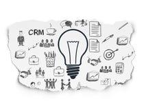 Concetto di affari: Lampadina su carta lacerata Immagini Stock