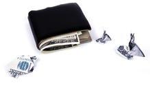 Concetto di affari: Origami coniglio e tartaruga di valuta del dollaro con il vecchio portafoglio nero Immagine Stock