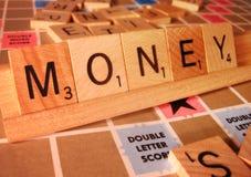 Concetto di affari - parola di Scrabble dei soldi Fotografia Stock