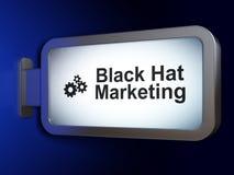 Concetto di affari: Vendita black hat ed ingranaggi sul fondo del tabellone per le affissioni Fotografia Stock