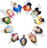 Concetto di aspirazione di amicizia dei bambini di innocenza di diversità Immagini Stock Libere da Diritti