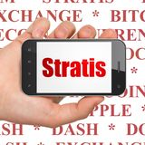 Concetto di Blockchain: Mano che tiene Smartphone con Stratis su esposizione Fotografia Stock