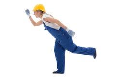 Concetto di carriera - eseguendo donna in uniforme blu del costruttore isolata immagini stock