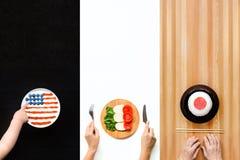 concetto di corsa Alimento sotto forma di bandiere dei paesi differenti Fotografie Stock Libere da Diritti
