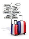 concetto di corsa Valigie e cartello che cosa da visitare in Francia Fotografia Stock