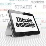 Concetto di Cryptocurrency: Computer della compressa con lo scambio di Litecoin su esposizione Immagini Stock Libere da Diritti