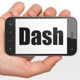 Concetto di Cryptocurrency: Mano che tiene Smartphone con il un poco su esposizione Immagine Stock Libera da Diritti